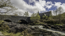 Old church, stone bridge and mountain stream